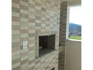 Foto do Apartamento-Apartamento:  - 02 Dormitórios sendo uma suíte - Sala para dois ambientes - Cozinha - Banheiro social - Sacada com churrasqueira  - Área de serviço - 01 Vaga de