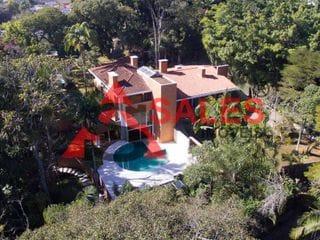 Foto do Sobrado-Casa em condomínio com 5 suítes, 7 vagas, piscina, sauna, academia, jacuzzi externa. Chácara Flora.